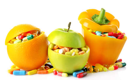 Photo pour Orange fruit, apple and bell-pepper and colorful pills, isolated on white - image libre de droit