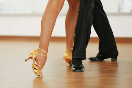Photo for Beautiful womanish and masculine legs in active ballroom dance, indoors - Royalty Free Image