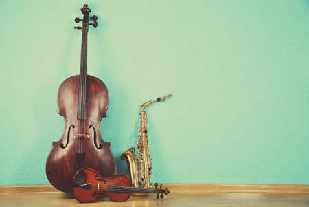 Photo for Musical instruments on turquoise wallpaper background - Royalty Free Image