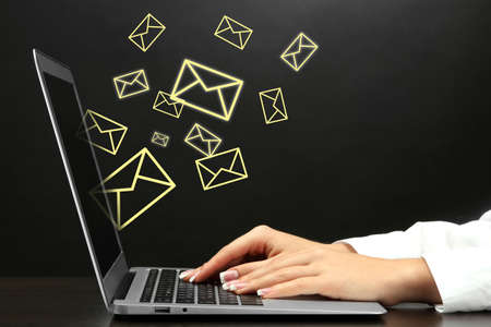 Foto de Email concept with laptop and hands - Imagen libre de derechos