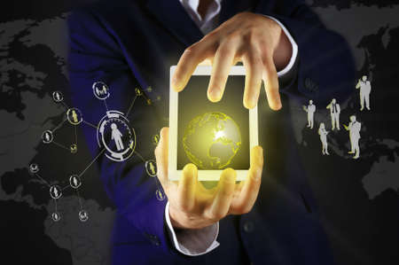 Businessman holding tablet-pc with social network structure