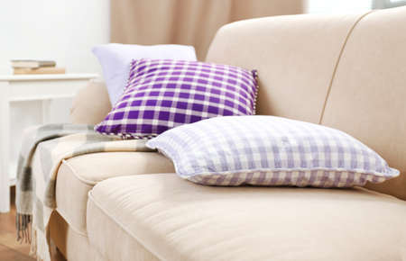 Photo pour Interior design with pillows on sofa, closeup - image libre de droit