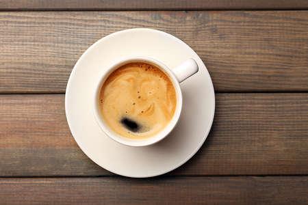 Foto für Cup of coffee on wooden table, top view - Lizenzfreies Bild