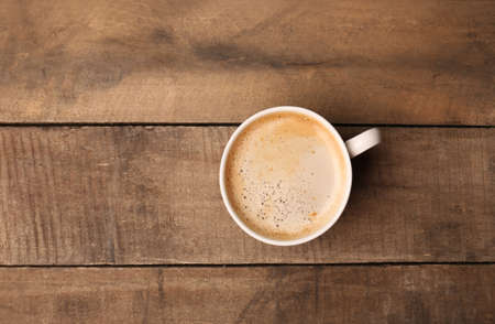 Photo for Cup of coffee on wooden table, top view - Royalty Free Image