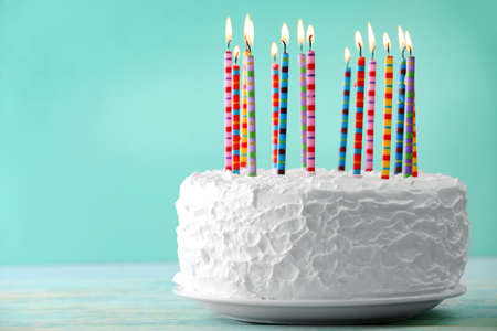 Photo for Birthday cake with candles on color background - Royalty Free Image