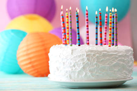 Photo for Birthday cake with candles on colorful background - Royalty Free Image