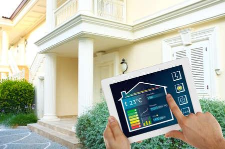Foto de Smart energy controller or remote home control online on tablet-pc - Imagen libre de derechos