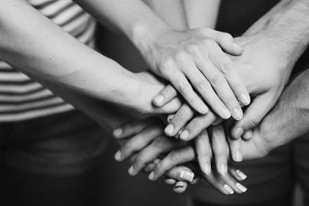 Photo pour United hands close up.  Black and white retro stylization - image libre de droit