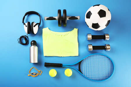 Photo pour Sports equipment and T-shirt on color table, top view - image libre de droit