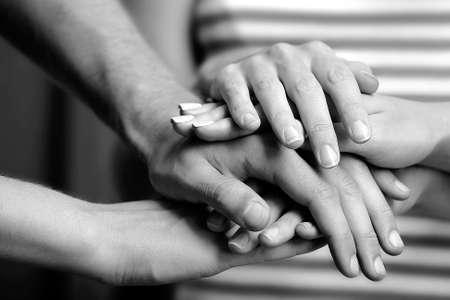 Foto de United hands close up.  Black and white retro stylization - Imagen libre de derechos