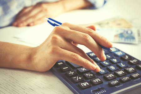 Photo pour Accounting concept.Analyzing finance report with calculator - image libre de droit