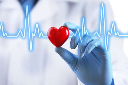 Foto de Doctor with small heart in hand - Imagen libre de derechos