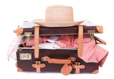 Photo pour Packing suitcase for trip isolated on white - image libre de droit