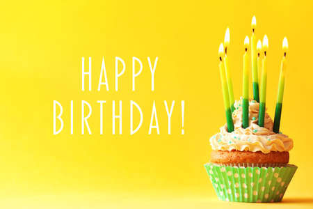 Photo for Birthday cupcake with candles on color background - Royalty Free Image
