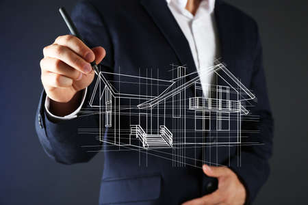 Foto de Real estate offer. Businessman drawing a model of the house - Imagen libre de derechos