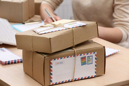 Foto de Cardboard boxes on work place in post office - Imagen libre de derechos