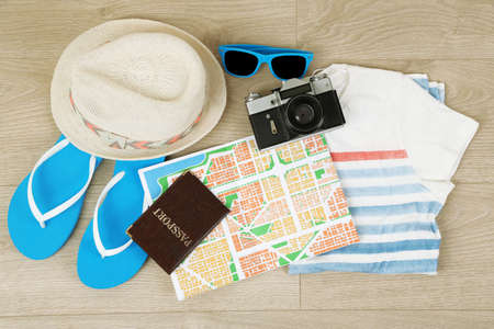 Photo for Summer vacation clothes, shoes and hat on wooden background - Royalty Free Image