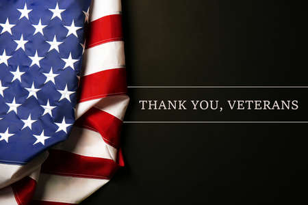 Foto für Text Thank A You, Veterans on black background near American flag - Lizenzfreies Bild