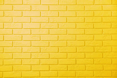 Foto de Yellow brick wall background - Imagen libre de derechos