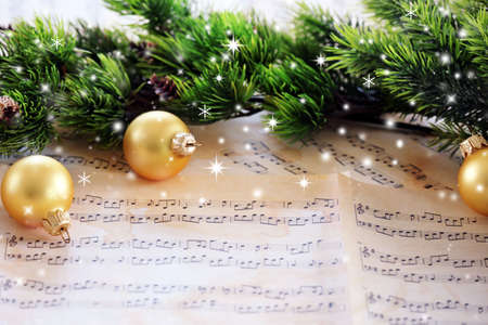 Photo for Christmas decorations on music sheets with snow effect - Royalty Free Image