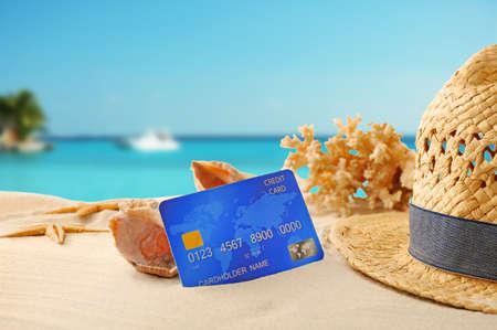 Foto de Credit card on holiday on blurred resort background - Imagen libre de derechos