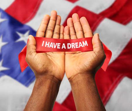 Foto de Martin Luther King Day. Male hands on Flag of United States of America background - Imagen libre de derechos