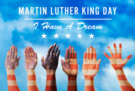 Photo pour Martin Luther King Day. Different hands on blue sky background - image libre de droit