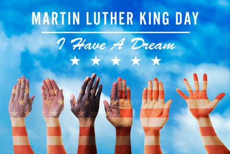 Foto de Martin Luther King Day. Different hands on blue sky background - Imagen libre de derechos