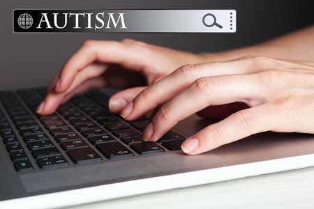 Foto de Female hands typing on laptop keyboard. Children autism concept - Imagen libre de derechos