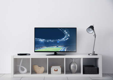 Foto de Watching football game on television at home. Leisure and entertainment concept. - Imagen libre de derechos