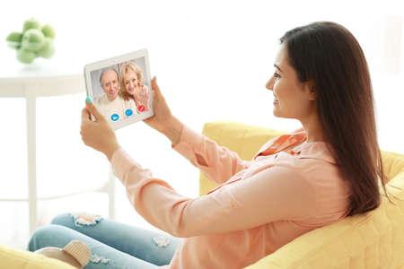 Foto de Video call and chat concept. Woman video conferencing on tablet - Imagen libre de derechos