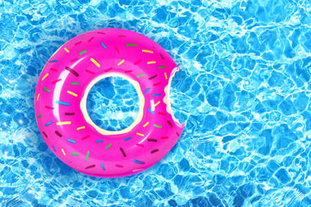 Photo for Inflatable colorful donut in swimming pool - Royalty Free Image