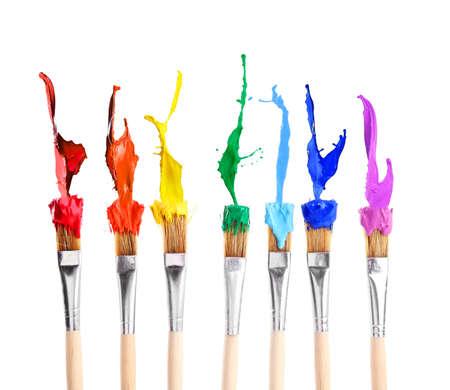 Photo for Brushes with rainbow splashes of paints on white background - Royalty Free Image