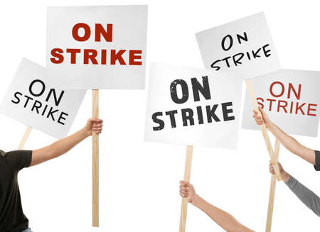 Photo pour People holding signboards with text ON STRIKE against white background - image libre de droit