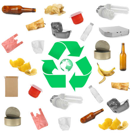 Foto de Different types of garbage and recycling sign on white background - Imagen libre de derechos