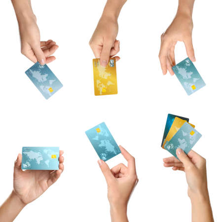 Foto de Women holding credit cards on white background - Imagen libre de derechos