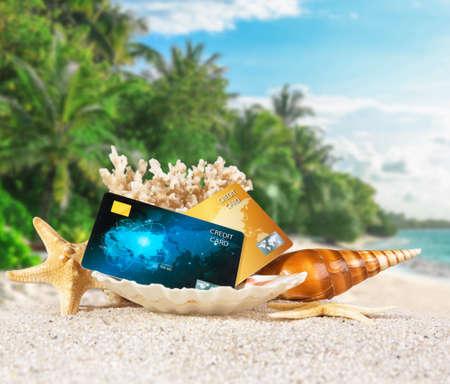 Photo pour Composition with credit cards on tropical beach - image libre de droit