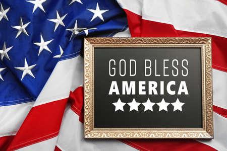 Foto de Frame with text GOD BLESS AMERICA on USA flag background - Imagen libre de derechos