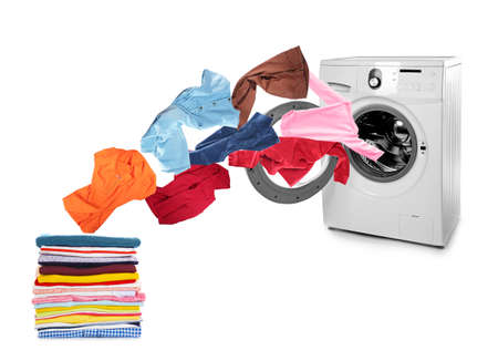 Photo for Washing machine and flying clothes on white background - Royalty Free Image