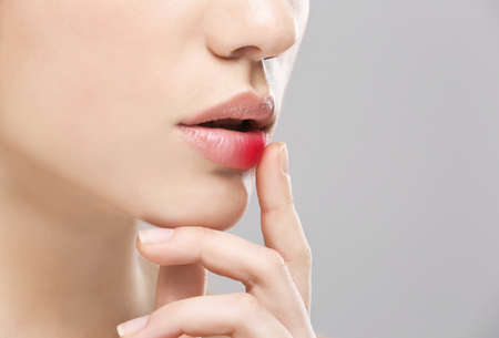 Foto de Female lips with herpes virus, closeup - Imagen libre de derechos