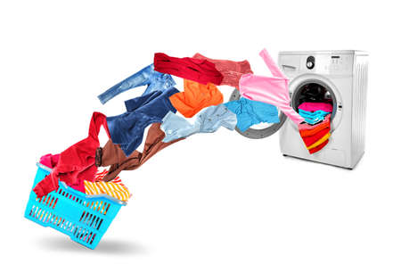 Photo pour Washing machine and flying clothes on white background - image libre de droit
