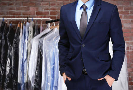 Photo for Dry cleaning concept. Businessman on blurred background - Royalty Free Image