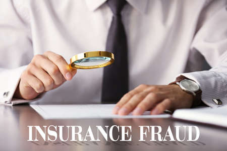 Photo for Insurance fraud concept. Man inspecting document with magnifier - Royalty Free Image