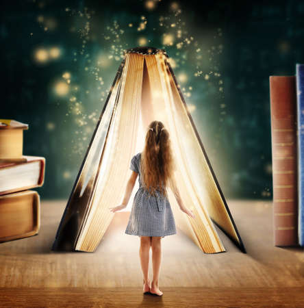 Photo for Adventure story and fairy tale. Tiny girl and book with magic glowing on table - Royalty Free Image