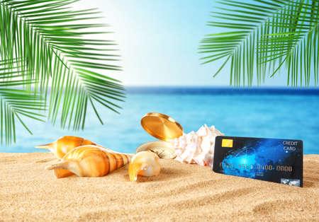 Photo pour Travel concept. Credit card with seashells on landscape background - image libre de droit