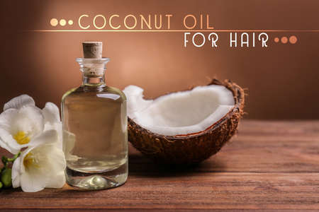 Photo for Coconut oil for hair. Cosmetic with flower and nut on color background - Royalty Free Image