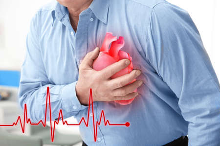 Foto de Heart attack concept. Senior man suffering from chest pain, closeup - Imagen libre de derechos