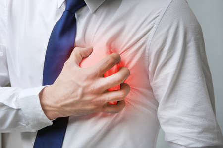 Foto de Heart attack concept. Man suffering from chest pain, closeup - Imagen libre de derechos