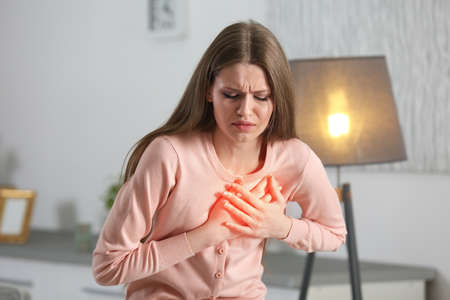 Photo pour Heart attack concept. Woman suffering from chest pain indoor - image libre de droit
