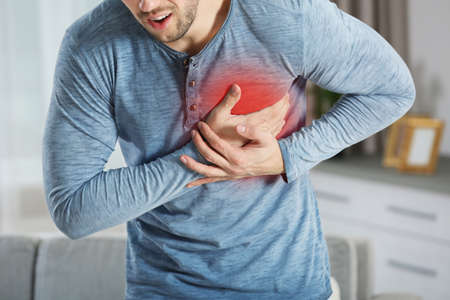 Photo for Heart attack concept. Man suffering from chest pain, closeup - Royalty Free Image